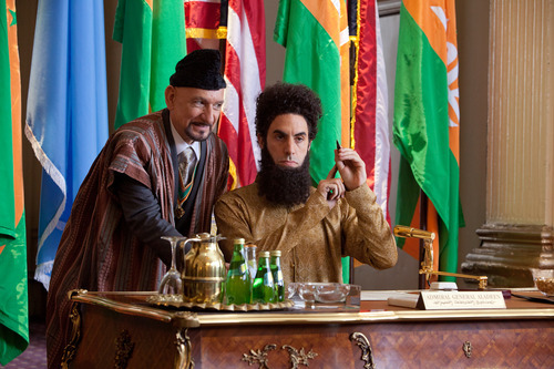 Sacha Baron Cohen portrays Admiral General Aladeen, right, and Ben Kingsley portrays Tamir in