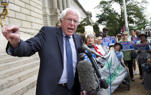 Sen. Bernie SAnders, I-Vt., addresses a rally outside a venue for the Peter G. Peterson Foundation's 2012 Fiscal Summit, Tuesday, May 15, 2012, in Washington.  (AP Photo/Manuel Balce Ceneta)