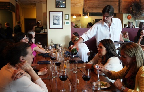 Kim Raff | The Salt Lake Tribune Long tables that seat 8, 10, 12 or more have been part of bars, barbecue joints and pizzerias for many years. But now communal tables are moving beyond casual eateries and into upscale restaurants, including The Copper Onion in Salt Lake City.