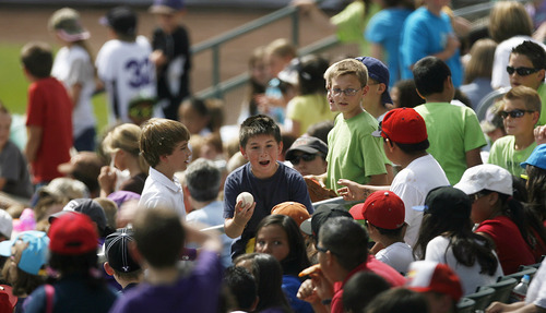 Francisco Kjolseth  |  The Salt Lake Tribune A.J. Ramirez, 11, center, of Whittier Elementary shows off his ball while the Salt Lake Bees host the Albuquerque Isotopes on Tuesday, May 15, 2012, as baseball tries to grow the next generation of fans through things like Tuesday's annual school day game at Spring Mobile Ballpark.