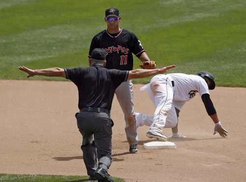 Francisco Kjolseth  |  The Salt Lake Tribune Luis Jimenez of the Salt Lake Bees slides in safe ahead of Ivan DeJesus, Jr. of the Albuquerque Isotopes on Tuesday, May 15, 2012, as baseball tries to grow the next generation of fans through things like Tuesday's annual school day game at Spring Mobile Ballpark.