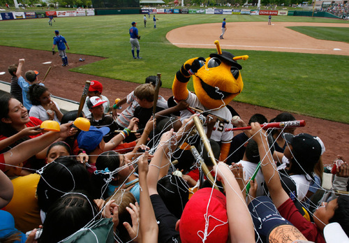 Salt Lake City - Bumble the Salt Lake City Bees mascot silly strings the young crowds gathered for Kids Day at Spring Mobile Ballpark on Tuesday, May 19, 2009.  Photo by Francisco Kjolseth/The Salt Lake Tribune 5/19/2009