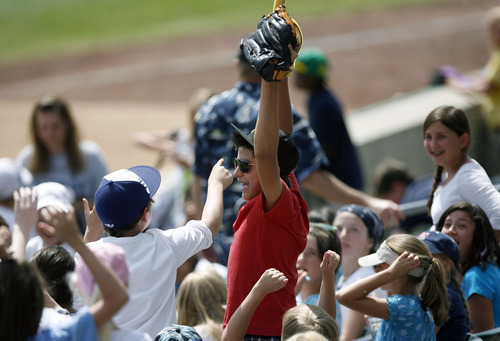 Francisco Kjolseth  |  The Salt Lake Tribune Gabriel Garduño, 12, of Highland Park Elementary celebrates his ball catch along with classmates as the Salt Lake Bees host the Albuquerque Isotopes on Tuesday, May 15, 2012, as baseball tries to grow the next generation of fans through things like Tuesday's annual school day game at Spring Mobile Ballpark.
