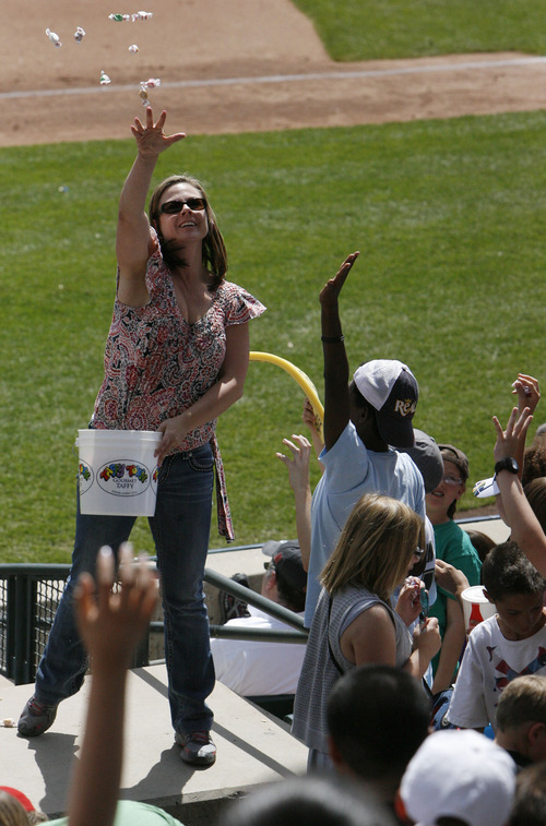 Francisco Kjolseth  |  The Salt Lake Tribune Jen Hogge tosses candy into the crowd during a break in the game as the Salt Lake Bees host the Albuquerque Isotopes on Tuesday, May 15, 2012, where baseball tries to grow the next generation of fans through things like Tuesday's annual school day game at Spring Mobile Ballpark.