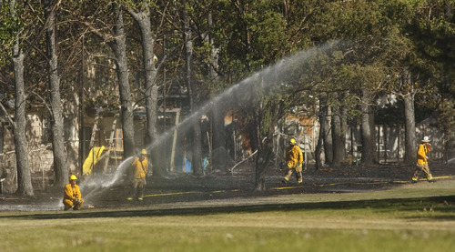 Leah Hogsten  |  The Salt Lake Tribune South Jordan firefighters were responding to a brush fire threatening homes in the area of 4247 W. Lochshire Circle (9670 South), Tuesday, May 15 2012 in South Jordan.that was said to have started on the Glenmoor Golf Course's 14th fairway. As of about 5:10 p.m. South Jordan firefighters said the blaze was under control.