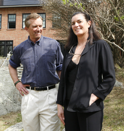 In this photo of April 6, 2010, Robert Kennedy Jr. and his wife Mary Richardson Kennedy pose for a photo outside their Bedford, N.Y. home. The estranged wife of Robert Kennedy Jr. was found dead at the family property, Wednesday, May 16, 2012, adding to the list of Kennedy family tragedies. She was an architect and designer and had overseen the renovation of the couple's home into an environmentally advanced showpiece. (AP Photo/Mark Vergari, The Journal News)
