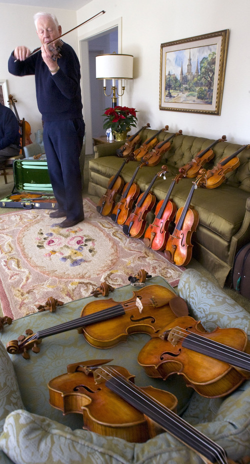 Al Hartmann  |  The Salt Lake Tribune Jack Ashton a violin teacher and player with the Utah Symphony plays and rates some of the violins donated by Peggy Clark that were made by her late husband Homer to the Southshore Conservatory in Hingham, Mass.