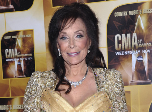 In this Nov. 10, 2010 file photo, singer Loretta Lynn poses in the press room during the 44th Annual Country Music Awards in Nashville, Tenn. Newly discovered documents indicate country music legend Loretta Lynn is three years older than she has led people to believe, a change that undermines the story told in
