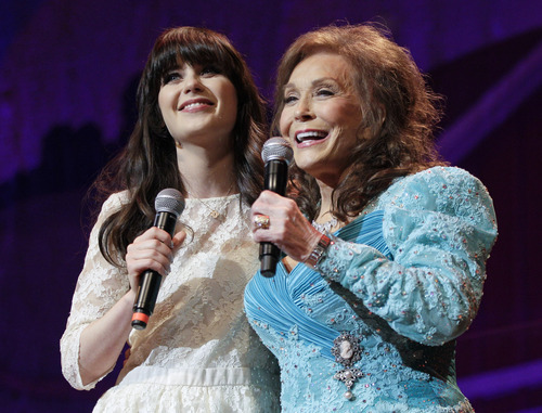 Country music star Loretta Lynn, right, and actress Zooey Deschanel sing Lynn's hit
