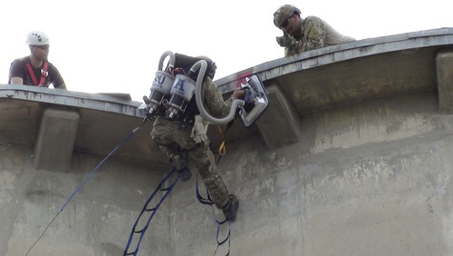 An Air Force soldier climbs onto the top of an Ohio cement silo last month using a device designed and built by USU engineering students for the Air Force Research Laboratory's annual design competition. The USU equipment, called the Personnel Vacuum Assisted Climber, or PVAC, won the event.  Courtesy Utah State University