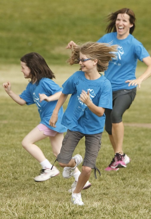 Leah Hogsten  |  The Salt Lake Tribune Mentor Chelle Brain chases the girls during agility and speed exercise.  Morningside Elementary 3rd -6th grade girls run into shape after school for a 5k run with the guidance of  trained coaches that mentor the girls Wednesday, May 16 2012 in Salt Lake City..  Girls on the Run is a national non-profit in 43 states. The 12-week program concludes with all participants walking or running in a 5K (3.1 mile) event.
