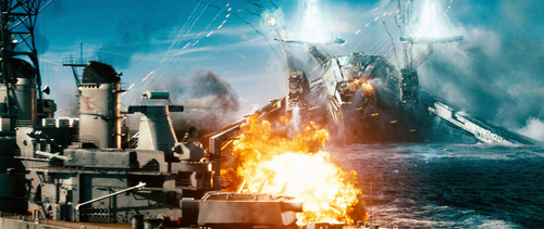 In this film publicity image released by Universal Pictures, a naval ship is attacked by an invader in a scene from