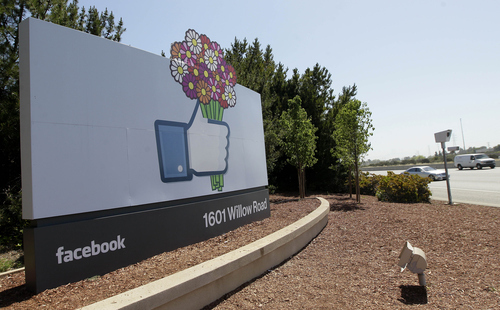This May 11, 2012, photo shows a sign is shown at the Facebook campus in Menlo Park, Calif.  Half of Americans think Facebook is a passing fad, according to the results of an Associated Press-CNBC poll. And, in the run-up to the social network's initial public offering of stock, half of Americans also say the social network's asking price is too high. (AP Photo/Jeff Chiu)