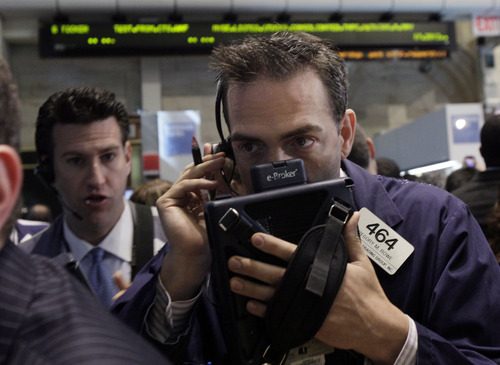 (AP Photo/Richard Drew) On Friday the Dow Jones industrial average dropped 73.11 points, to close at 12,369.38. It fell 3.5 percent for the week.