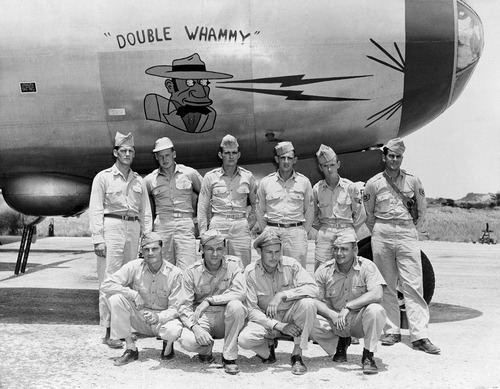 Crew members of ?Double Whammy,? described by the air force as first Boeing B-29 to drop bombs in Korean War, are shown by their ship at 20th Air Force headquarters in Far East on July 16, 1950. Standing (left to right) are: Pfc. A.A. Zyjewski, Wyandotte, Mich.; Cpl. H.E. Rinerson, Ada, Minn.; Cpl. E.H. Armstrong, Cleveland, O.; Sgt. K. Waymire, Indianapolis, Ind.; Sgt. S. T. Henson, Cincinnati, O.; Sgt. J.P. Bouchard, Manistique, Mich. From row (left to right) are: Lt. William C. Woodworth, Oklahoma City, Okla.; Lt. Pierre E. Nys, Lynnhaven, Va., Lt. Dave F. Kimberly, Uka, Miss.; and Lt. Bob G. Goold, Provo, Utah. (AP Photo)