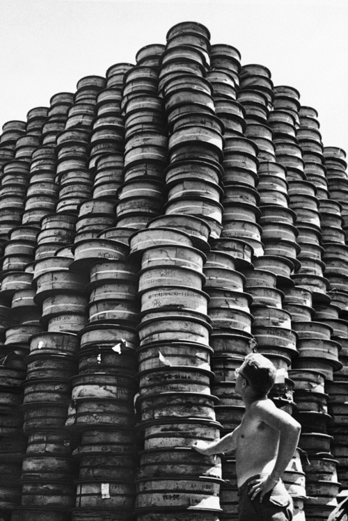 Cpl. Charles H. Faulkner of Salt Lake City, Utah, checks over a ?mountainous? pile of rolled communication wire ?somewhere in Korea?  Sept. 1, 1950 (AP Photo)