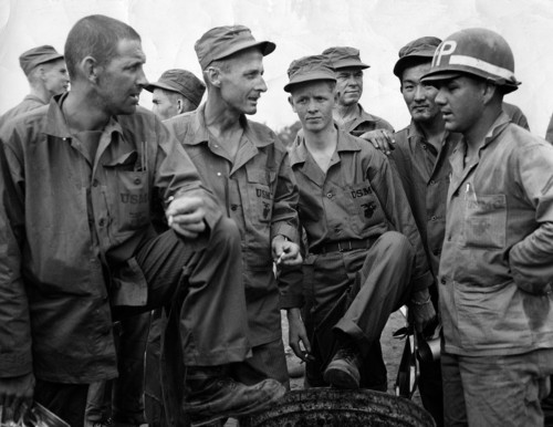 U.S. prisoners during the Korean War are Released. From left to right are; S/Sgt James B. Nash of Durban, N.C.; T/Sgt Charles. L. Harrison of Tulsa, Oklahoma; PFC John A. Haring pf Painted Post, N.Y.; Army Cpl. Saburo Shimoura of Ogden, Utah; Cpl. Paul A. Witmer of Homesville, Pa. This photo was taken June 4, 1951. (AP Photo)