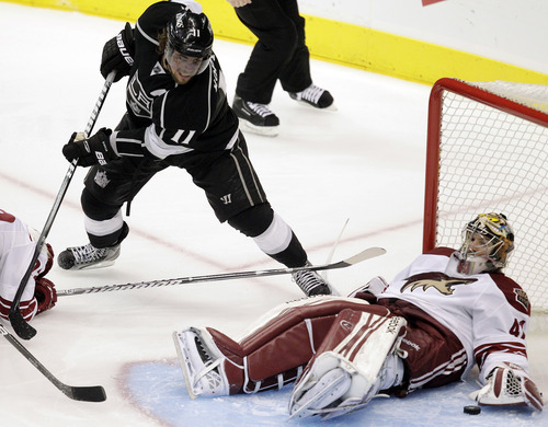 Phoenix Coyotes goalie Mike Smith, right, stops a shot as Los Angeles Kings center Anze Kopitar, of Slovenia, watches during the second period of Game 4 of the NHL hockey Stanley Cup Western Conference finals in Los Angeles, Sunday, May 20, 2012. (AP Photo/Jae C. Hong)