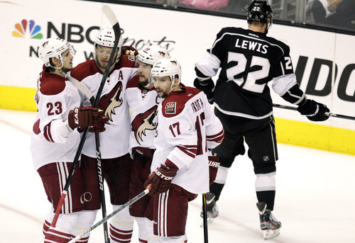 From left, Phoenix Coyotes' Oliver Ekman-Larsson, of Sweden, Martin Hanzal, of the Czech Republic, Shane Doan and Radim Vrbata, of the Czech Republic, celebrate a goal by Doan during the first period of Game 4 of the NHL hockey Stanley Cup Western Conference finals against the Los Angeles Kings in Los Angeles, Sunday, May 20, 2012. (AP Photo/Jae C. Hong)