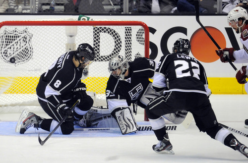 Phoenix Coyotes right wing Shane Doan, right, scores on Los Angeles Kings goalie Jonathan Quick, second from left, as defenseman Drew Doughty, left, and center Trevor Lewis defend during Game 4 of the NHL hockey Stanley Cup Western Conference finals, Sunday, May 20, 2012, in Los Angeles. (AP Photo/Mark J. Terrill)