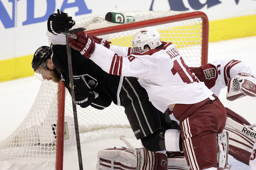 Los Angeles Kings center Jeff Carter, left, is pushed by Phoenix Coyotes defenseman Rostislav Klesla, of Czech Republic, during the first period of Game 4 of the NHL hockey Stanley Cup Western Conference finals in Los Angeles, Sunday, May 20, 2012. (AP Photo/Jae C. Hong)