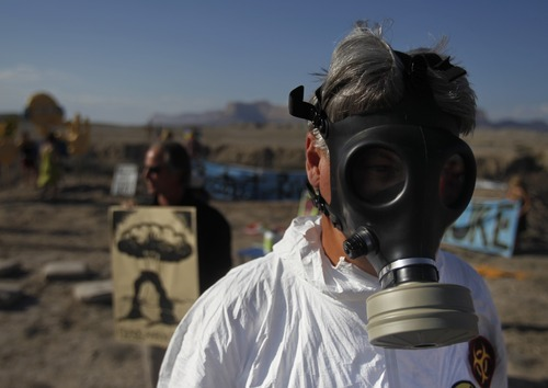 Kim Raff | The Salt Lake Tribune Craig Cain with nogreenrivernuke.org joins protesters in a parade during a rally near the proposed construction site for nuclear reactors in Green River, Utah on May 19, 2012.