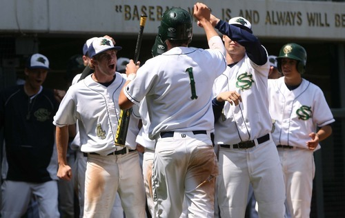 Leah Hogsten  |  The Salt Lake Tribune  Snow Canyon's Brayden Linde  is congratulated for his run in the 5th.  Snow Canyon High School boys baseball team defeated Juan Diego during their final 3A State Championship Game 5-1 Saturday, May 19 2012 in Kearns.