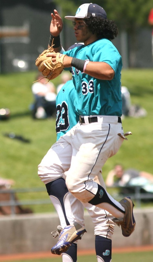 Leah Hogsten  |  The Salt Lake Tribune  Juan Diego's Kalei Kaahaaha jumps and high-fives his teammates after the game. Juan Diego High School boys baseball team defeated Snow Canyon during their first 3A State Game to force a second Saturday, May 19 2012 in Kearns.