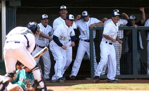 Leah Hogsten  |  The Salt Lake Tribune  Snow Canyon's coaches and players leap out of the dugout to congratulate pitcher Austin Ovard for a shut out 6th inning. Snow Canyon High School boys baseball team defeated Juan Diego during their final 3A State Championship Game 5-1 Saturday, May 19 2012 in Kearns.