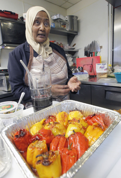 Al Hartmann  |  The Salt Lake Tribune Muna Ali, a Sudanese refugee, cooks food at Mahider, an Ethiopian restaurant this week. She was preparing dishes as part of her growing catering business, which has grown with the support of a Salt Lake County program.