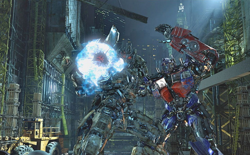 In this undated image released by Universal Studios Hollywood, characters Megatron, left, and Optimus Prime are displayed during the