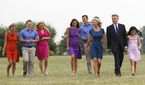 FILE - In this June 21, 2011, file photo former Utah Gov. Jon Huntsman, walks with his wife, Mary Kaye, respectively second and third from right, and their seven children at Liberty State Park in Jersey City, N.J., before announcing his bid for the 2012 Republican presidential nomination. Huntsman was expected to be a force in the 2012 race long before he officially joined it. Handsome and well-spoken, the 51-year-old California native offered a unique set of qualifications as a former GOP governor with experience working under presidents of both parties. From left are children Liddy Huntsman, Willliam Huntsman, Mary Anne Huntsman, Abby Huntsman Livingston, Jon Huntsman III, and Gracie Mei Huntsman, right. Youngest adopted daughter, Asha Bharati Huntsman, is partially visible behind her mother. (AP Photo/Mel Evans, File)