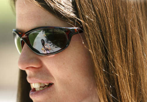 Trent Nelson  |  The Salt Lake Tribune Christy Smith watched her daughter Megan (reflected in the sunglasses) ride a scooter in Liberty Park Tuesday, May 22, 2012 in Salt Lake City, Utah. A new national report urges states to adopt laws requiring helmets for motorcyclists and children on bicycles, but Utah safety advocates say that would be an uphill political battle here.