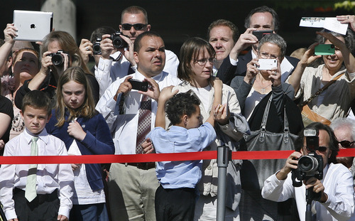 Scott Sommerdorf  |  The Salt Lake Tribune              People strain for a view to make photos of the groundbreaking for the Provo City Center Temple, formerly known as the Provo Tabernacle. Elder Jeffrey R. Holland of the Twelve conducted the ceremony on Saturday.