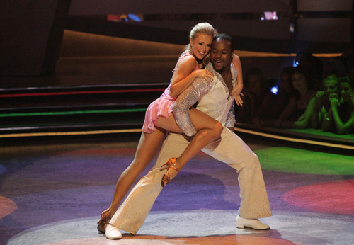 Chelsie Hightower, left, and Joshua Allen perform a disco routine on