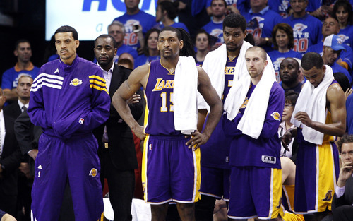 From left, Los Angeles Lakers' Matt Barnes, Metta World Peace, Andrew Bynum and Steve Blake watch from the bench during the final minute in the fourth quarter of Game 5 in their NBA basketball Western Conference semifinal playoff series against the Oklahoma City Thunder, Monday, May 21, 2012, in Oklahoma City. Oklahoma City won 106-90. (AP Photo/Sue Ogrocki)
