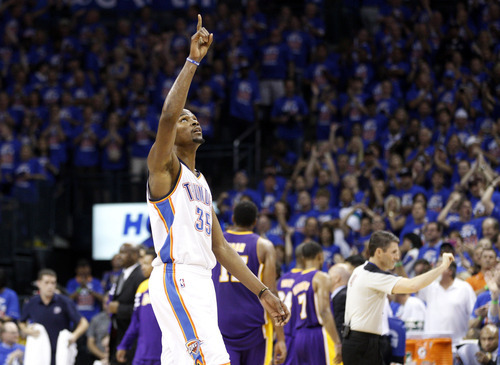 Oklahoma City Thunder forward Kevin Durant points up during a timeout in the fourth quarter of Game 5 against the Los Angeles Lakers in their NBA basketball Western Conference semifinal playoff series, Monday, May 21, 2012, in Oklahoma City. Oklahoma City won 106-90. (AP Photo/Sue Ogrocki)