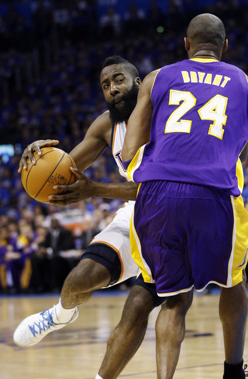 Oklahoma City Thunder guard James Harden, left, is fouled by Los Angeles Lakers guard Kobe Bryant (24) as he drives to the basket in the first quarter of Game 5 in their NBA basketball Western Conference semifinal playoff series, Monday, May 21, 2012, in Oklahoma City. (AP Photo/Sue Ogrocki)