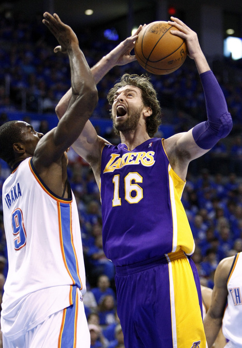 Los Angeles Lakers forward Pau Gasol (16) shoots in front of Oklahoma City Thunder forward Serge Ibaka (9) during the first quarter of Game 5 in their NBA basketball Western Conference semifinal playoff series, Monday, May 21, 2012, in Oklahoma City.  (AP Photo/Alonzo Adams)