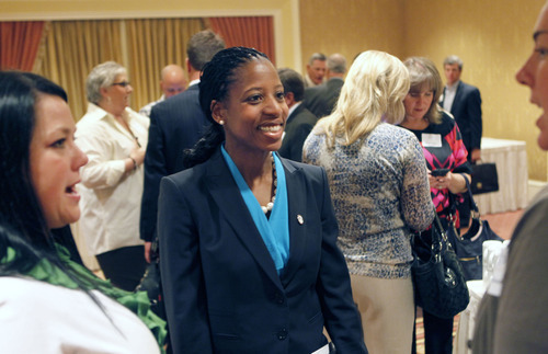Al Hartmann  |  The Salt Lake Tribune Saratoga Springs Mayor Mia Love, who is running for Congress in Utah's new 4th District, mingles with participants in the annual Utah Taxpayers Association conference Tuesday at Little America Hotel. Love came out swinging against rival, Rep. Jim Matheson, D-Utah.