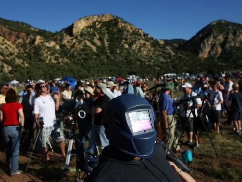 Kim Raff | The Salt Lake Tribune Amaleah Barker wears a welding mask to view the annular solar eclipse in Kanarraville, Utah on May 20, 2012.