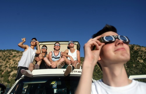 Kim Raff | The Salt Lake Tribune People from Mapleton, Utah gather at the viewing area and watch the annular solar eclipse in Kanarraville, Utah on May 20, 2012.