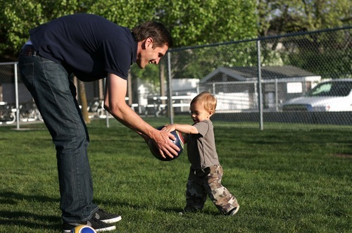 Kim Raff | The Salt Lake Tribune Josh Romney plays with his son Sawyer Romney on a recent day in Holladay. Romney, son of presidential candidate Mitt Romney, says stereotypes of his father as robotic and stiff couldn't be further from the truth. Josh Romney's five kids are among Mitt Romney's 18 grandchildren and the older Romney loves to get down and wrestle with the youngsters.