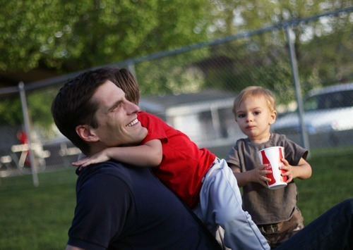 Kim Raff | The Salt Lake Tribune Josh Romney spends time with his family at his son's baseball practice at an LDS stake house in Holladay, Utah on May 3, 2012.