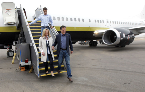 Republican presidential candidate, former Massachusetts Gov. Mitt Romney, his wife Ann and son Josh, arrive in Minneapolis, Wednesday, Feb. 1, 2012. (AP Photo/Gerald Herbert)