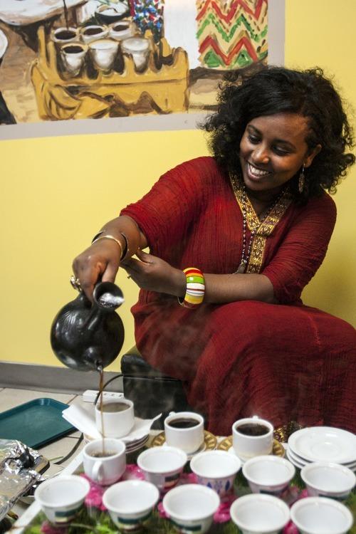 Chris Detrick     The Salt Lake Tribune Meseret pours traditional Ethiopian coffee at Mahider Ethiopian Restaurant in Salt Lake City on Friday May 18, 2012.
