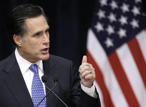 Republican presidential hopeful, former Massachusetts Gov. Mitt Romney gestures during his address entitled,