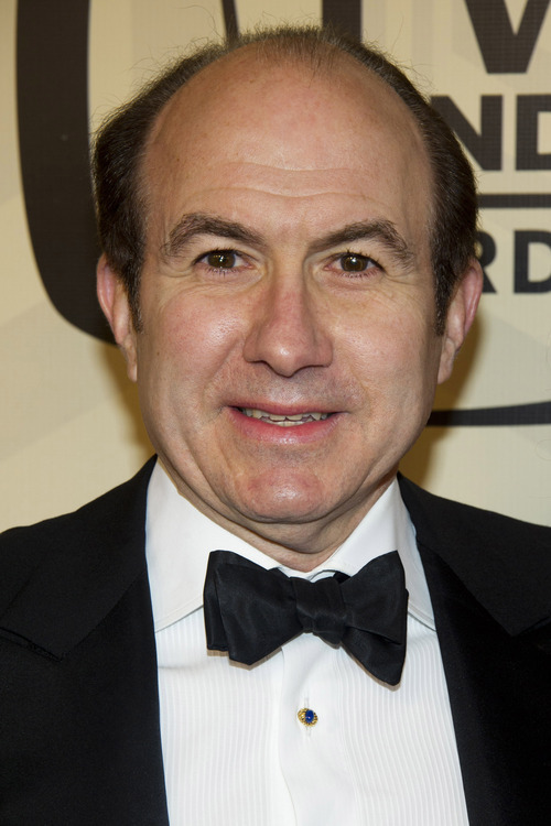 FILE - In this April 14, 2012 file photo, Viacom CEO Philippe Dauman arrives to the TV Land Awards 10th Anniversary in New York. Dauman is one of the top 10 highest paid CEOs at publicly held companies in America last year, according to calculations by Equilar, an executive compensation data firm, and The Associated Press. The Associated Press formula calculates an executive's total compensation during the last fiscal year by adding salary, bonuses, perks, above-market interest the company pays on deferred compensation and the estimated value of stock and stock options awarded during the year.(AP Photo/Charles Sykes, File)