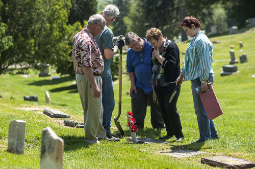Chris Detrick  |  The Salt Lake Tribune Marvin Shafer, Frank Shafer, Don Pinkerton, Susan Shafer Campbell Pinkerton and Liz Shafer Zentner visit the grave site of their relatives Elinor V. Gullette and Elinor M. Marx at Salt Lake City Cemetery on Saturday May 19, 2012.  The Shafer family visits the grave sites of family members every year to place flowers.