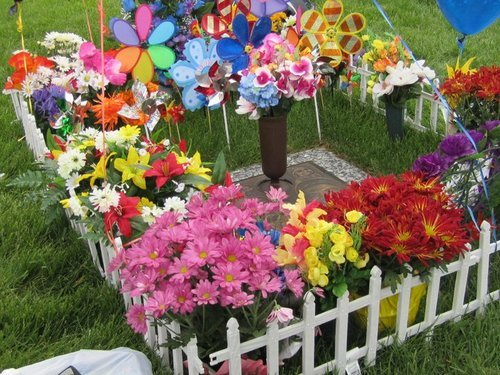 Grace Rodriguez and her family decorate her son's gravesite on Memorial Day. Courtesy image
